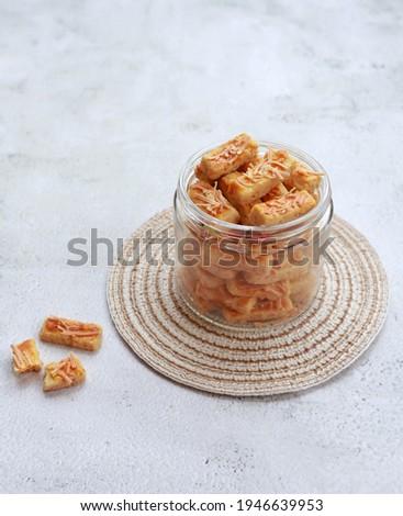 Kastengel or kue keju or kaastangel or kaastengel is Dutch influenced-Indonesian cheese cookie in the form of sticks, commonly found when Ied Al fitr or Lebaran. Selective focus.  Сток-фото ©