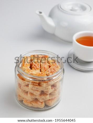 Kastengel or kue keju or kaastangel or kaastengel is Dutch influenced-Indonesian cheese cookie in the form of sticks, commonly found when Lebaran. Selective focus.  Сток-фото ©