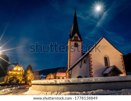 Katchberg church in a winter evening under the stars and the moon Stock fotó ©