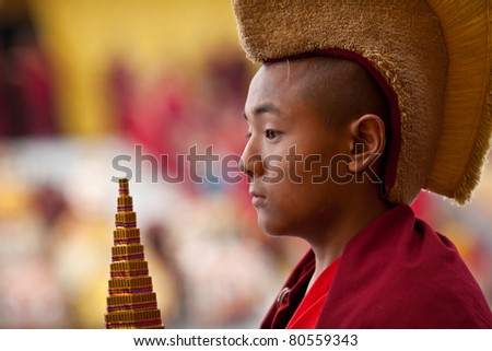 KATHMANDU - MARCH 25: An unidentified buddhist monk during Tsam mystery on March 25, 2010 in Kathmandu, Nepal. Through the language of dancing and pantomime Tsam tells about patrons of Buddhism