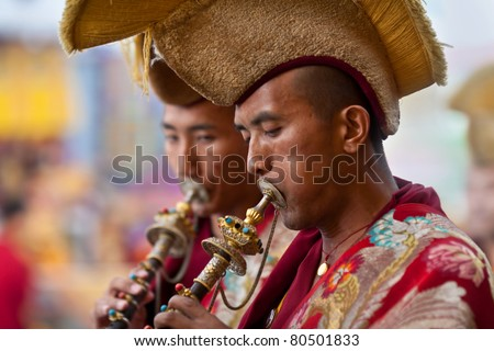 KATHMANDU - MARCH 25: Unidentified Buddhist lamas play music during Tsam mystery on March 25, 2010 in Kathmandu, Nepal. Through the language of dancing and pantomime Tsam tells about patrons of Buddhism