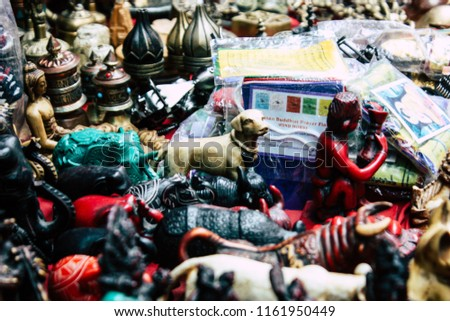Kathmandu Nepal August 22, 2018 Closeup of decorative statues of Buddha sold in a souvenirs shop at Thamel street in Kathmandu #1161950449