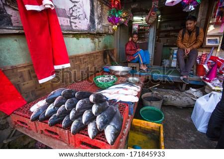 KATHMANDU, NEPAL - DEC 18: Unidentified street vendor in historic center of city, Dec 18, 2013 in Kathmandu, Nepal. Largest city of Nepal, its historic center, a population of over 1 million people.