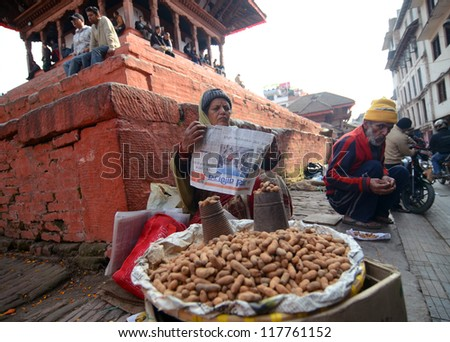KATHMANDU, NEPAL - FEBRUARY 2 : Local people on the street sell local produce. The basic branch of economy in Nepal - agriculture (76 % of working population), February 2, 2012 in Kathmandu, Nepal