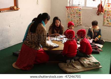 "KATHMANDU, NEPAL - JANUARY 1: A teacher conducts lessons in small primary school ""Happy Home School"" in poor area of city, January 1, 2009 in Kathmandu, Nepal."