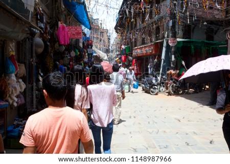 KATHMANDU, NEPAL - JULY 17, 2018: Street in the Thamel district, Kathmandu. Thamel is a tourist district with many hotels, souvenir shops, restaurants and nightlife #1148987966