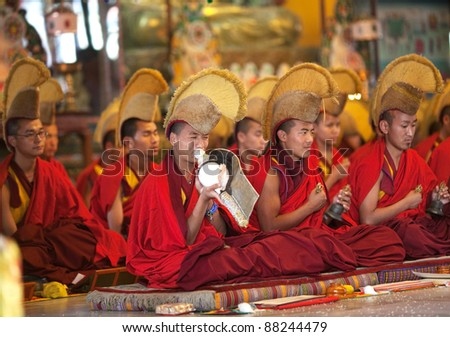KATHMANDU, NEPAL - MARCH 02: An unidentified  buddhist monks and lamas during puja ceremony in honour Losar holiday at Shechen monastery on March 02, 2010 in Boudnath, Kathmandu Valley, Nepal