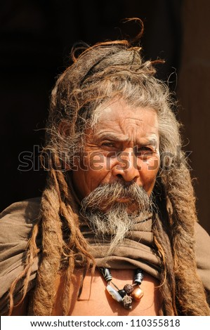KATHMANDU NEPAL MARCH 16 Ascetic monk smart looking Sadhu holy man with the long dreadlocks near Pashupatinath Temple in Kathmandu Nepal on March 16 2012