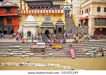 KATHMANDU, NEPAL - MAY 18: Cremation ceremony along the holy Bagmati River at Pashupatinath Temple complex, May 18, 2013 in Kathmandu, Nepal. This is the most sacred place to all Hindus in Nepal.