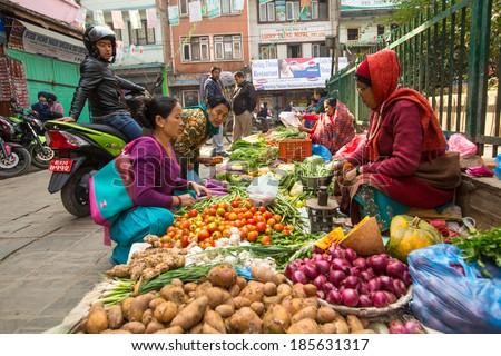 KATHMANDU, NEPAL - NOV 28, 2013: Unidentified street vendor in historic center of city. Largest city of Nepal, its economic center, a population of over 1 million people.