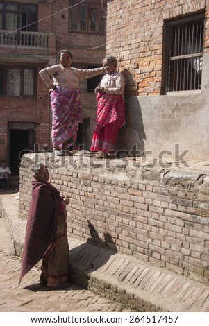 KATHMANDU, NEPAL, NOVEMBER 06, 2006: A group of women in Kathmandu tolking and working in the street of Kathmandu, Nepal