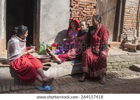 KATHMANDU, NEPAL,  NOVEMBER 06, 2006:  Unidentified women working in the street of Kathmandu, Nepal.