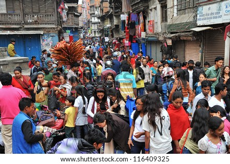 KATHMANDU - OCT 18: Nepali people rush for Dashain shopping on October 18, 2012, in Kathmandu, Nepal. Dashain is the most auspicious festival symbolizing the victory of the good over the evil.