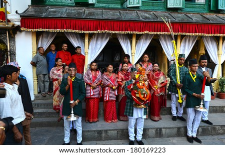 KATHMANDU - OCT 11: People of the Nepalese high society, the Royal ladies, gathered in the Royal Palace to celebrate the first day of the Dashain festival. On October 11, 2013 in Kathmandu, Nepal
