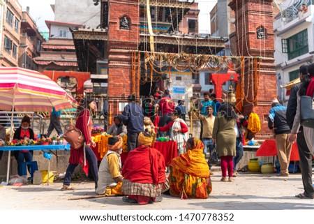 Kathmandu-18.03.2019: The beggars sitting neat temple at durbar square in Kathmandu #1470778352