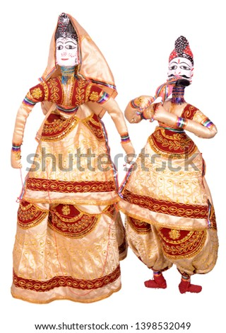 Kathputli is a string puppet theatre, naive to Rajasthan, India, and is the most popular form of Indian puppetry. it is controlled by a single string that passes from top of puppet over the puppeteers #1398532049