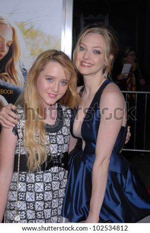 "Kathryn Newton and Amanda Seyfried at the ""Dear John"" World Premiere, Chinese Theater, Hollywood, CA. 02-01-10"