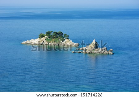 Katic and Sveta Nedjelja are two rocky islet opposite the town of Petrovac, Montenegro. The church Sveta Nedjelja stands on the smaller of two islands