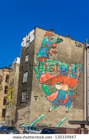 KATOWICE, POLAND - MARCH 04: The cock - mural by Aryz, well-known street art Spanish artist, on March 04, 2013. Remarkable piece of art created during annual Katowice Street Art Festival in 2011.