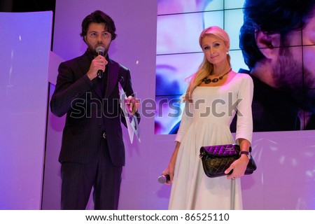 KATOWICE, POLAND - OCTOBER 12: Paris Hilton (with Olivier Janiak) at the opening of Silesia City Center on October 12, 2011 in Katowice, Silesia, Poland.