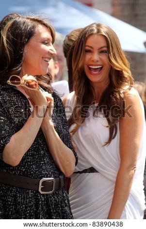 Katy Segal, Sofia Vergara at the Ed O'Neill Hollywood Walk Of Fame Induction Ceremony, Hollywood, CA. 08-30-11 - stock photo