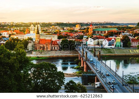 Kaunas, Lithuania. Aerial view of famous city Kaunas, Lithuania at sunset. Evening view of landmarks and car traffic road with trail lights