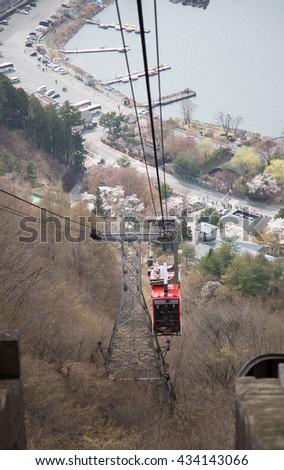 KAWAGUCHIKO, JAPAN - APRIL 13 : Kachi Kachi Ropeway serve for Tenjo Mountain on April 13, 2016. #434143066