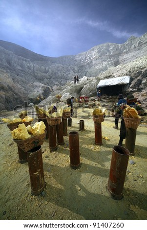 KAWAH IJEN, INDONESIA - SEPT 18 : Temporary raw sulfur station next to the hazardous mine in Kawah Ijen on 18 Sept 2010. Miner risk their life daily to carry these 80-100kg load to a nearby sugar factory