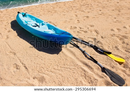 Kayak at the tropical beach. Water sport during vacation.