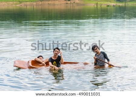 Kayak capsizing with asia man at natural water river (small boat) #490011031
