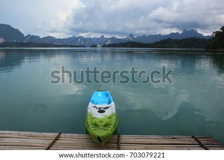 kayak in a reflecting lake....