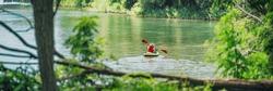 Kayak in summer nature lake lansdcape panoramic of outdoor watersport. Man kayaking in Canada banner.