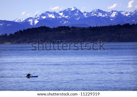 Kayak, Kayaking, on Puget Sound with Snowy Olympic Mountains in background, Edmonds, Snohomish County, Washington