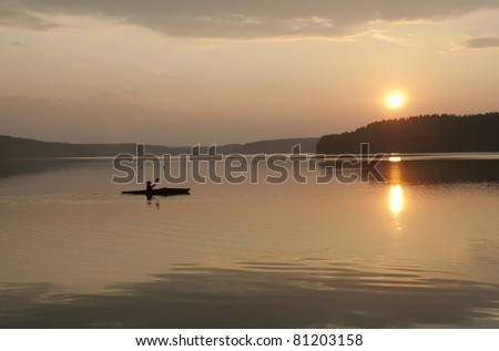 kayak on a lake in the sunset