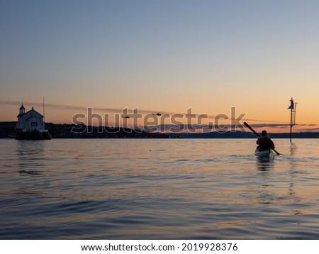 Kayak padling in spring sunset Stock fotó ©