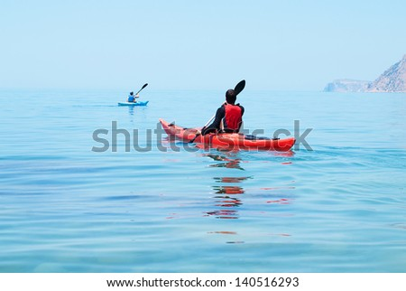 Kayak. People kayaking in the ocean. Active people. Sport and recreation