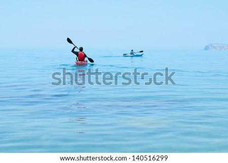 Kayak. People kayaking in the ocean. Active people. Sport and recreation