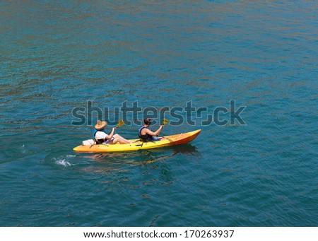 Kayak. People kayaking in the ocean.Top view