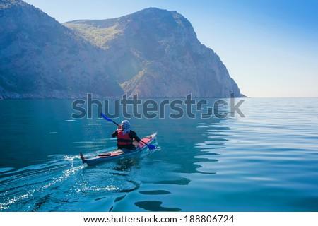 Kayak. People kayaking in the sea. Leisure activities on the calm blue water.