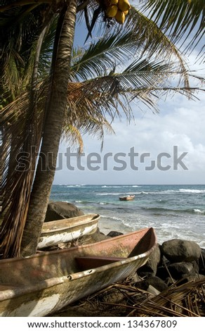 kayak small fishing paddle boats Caribbean Sea Big Corn Island Nicaragua Central America - stock photo