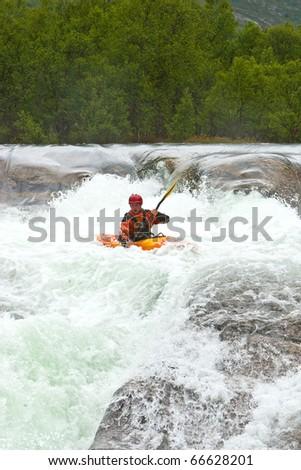 Kayak trip on the waterfalls in Norway