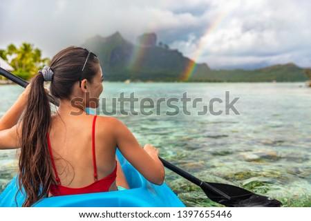 Kayak woman watersport activity tourist enjoying kayaking in Bora Bora at Mount Otemanu, Tahiti, French Polynesia. Active ocean sport lifestyle. #1397655446
