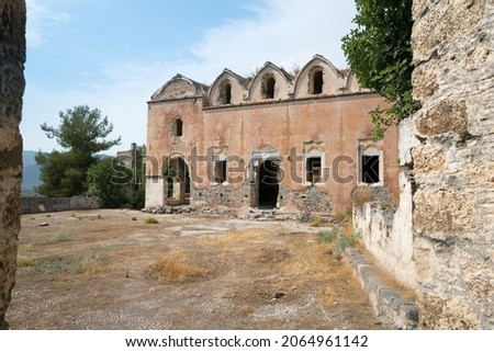 Kayaköy Abandoned ghost town, stone houses and ruins. The site of the 18th-century Ancient Greek city of Karmilissos. Ancient church. Fethiye - TURKEY