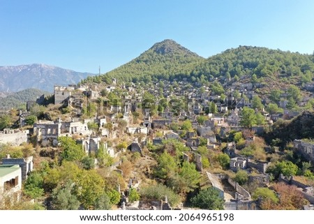 Kayaköy Abandoned ghost town, stone houses and ruins. The site of the 18th century Ancient Greek city of Karmilissos. Aerial view, Fethiye – TURKEY