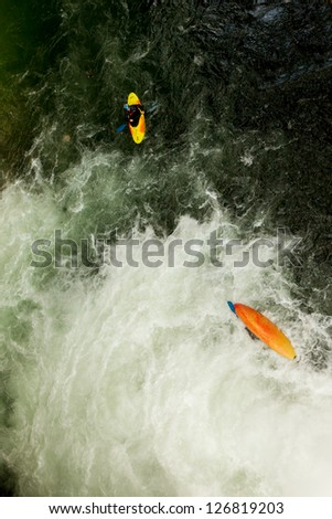 KAYAKER EMERGING FROM UNDERWATER AFTER A HIGH JUMP