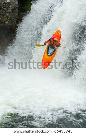 Kayaker jumping from the waterfall