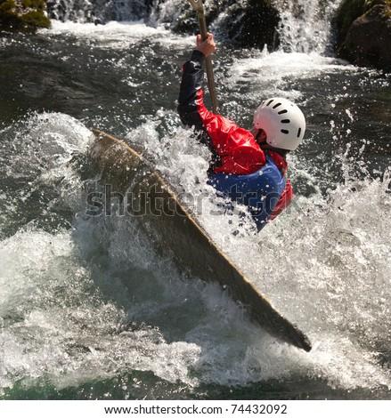 kayaker maneuvering at river treska ,in canyon Matka Macedonia - stock photo
