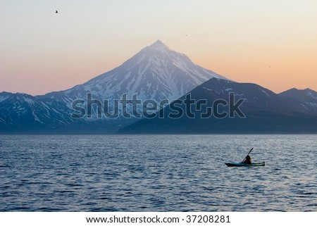 Kayaker sails by the ocean