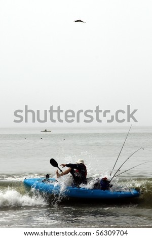 Kayaker surprised by a wave