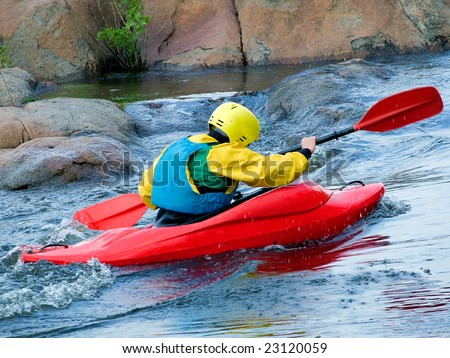 kayaker with an oar on the water